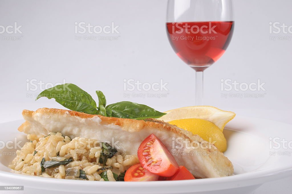 Snapper with Risotto and rose royalty-free stock photo