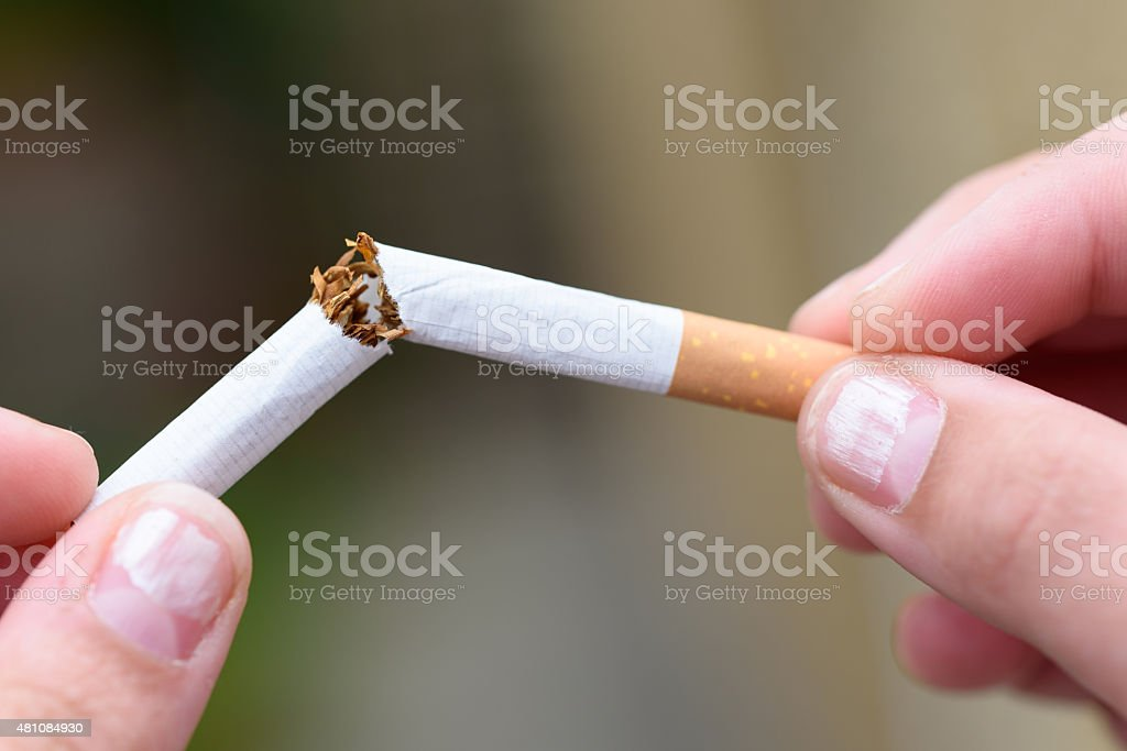 Snapping a Cigarette stock photo