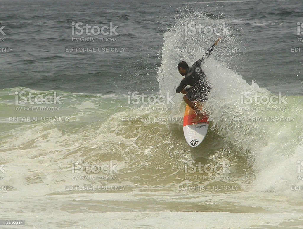 Snapping a green wave stock photo