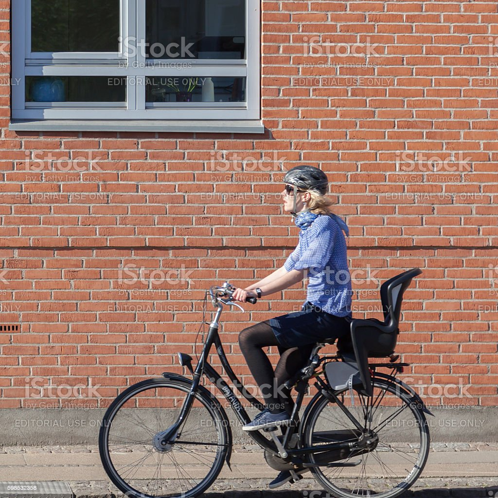 Snaps of blurred people riding bicycle in Copenhagen photo libre de droits