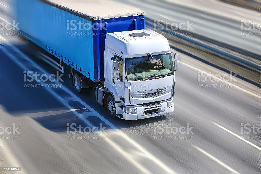 Snapshot of heavy duty truck moving on highway stock photo