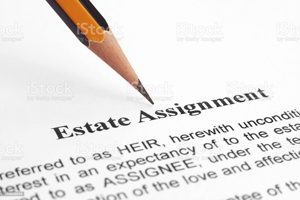 Snapshot of pencil pointing at estate assignment agreement royalty-free stock photo