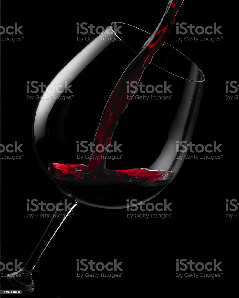 Snapshot of red wine pouring into crystal glass royalty-free stock photo