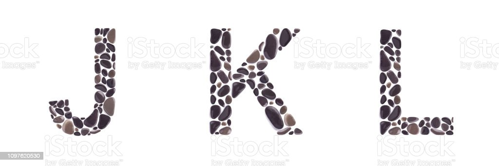 J, K snd L letters made of stones isolated on white background J, K and L letters made of beach stones isolated on white background Alphabet Stock Photo