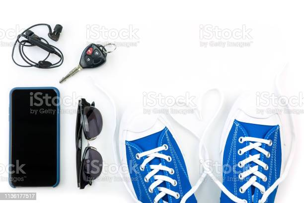 Sneaker and mobile phone and travel accessories isolated on white picture id1136177517?b=1&k=6&m=1136177517&s=612x612&h=7fyeq3hoclmqvyduaq81w6w laadc1fggstshtgotja=