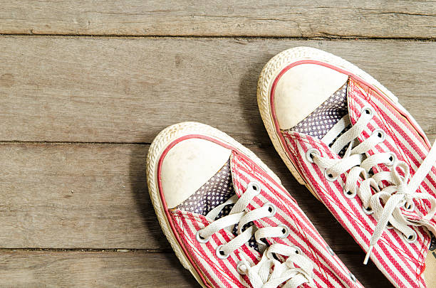 sneaker on wooden sneaker on wooden background all star stock pictures, royalty-free photos & images