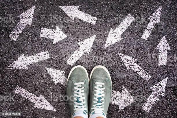 Sneaker Shoes And Arrows Pointing In Different Directions On Asphalt Ground Choice Concept - Fotografias de stock e mais imagens de Adolescente