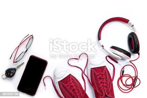 917262406istockphoto Sneaker shoes , mobile phone and other  accessories such as headphone , car key and eyeglass on white background , top view and copy space 892830790