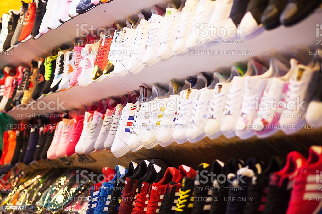 Sneaker shoes on night bazaar in Bangkok stock photo