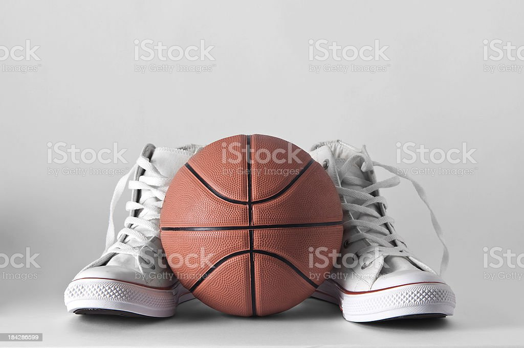Sneakers and Basketball stock photo