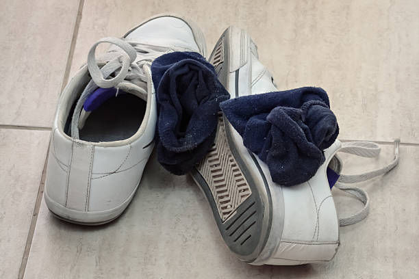 sneakers and socks - dirty shoes stock photos and pictures