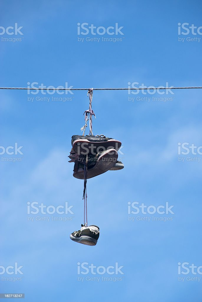 Sneakers Hanging by Laces on Utility or Power Line stock photo