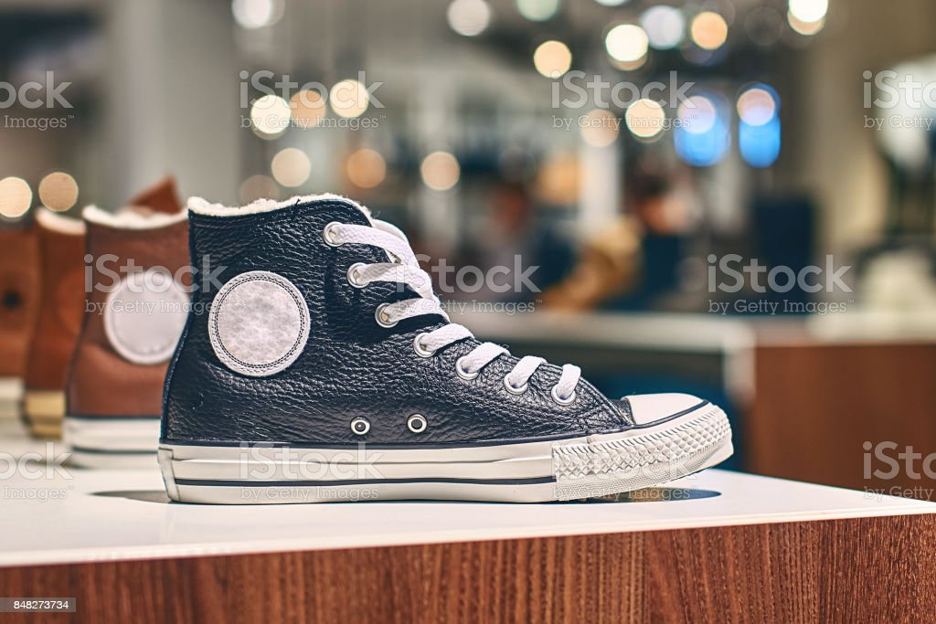 Sneakers in a luxury store stock photo
