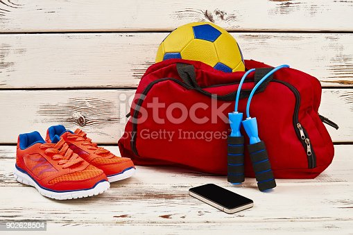 istock Sneakers, mobile phone and equipment 902628504