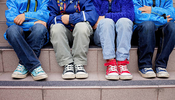 Sneakers on a kids feet stock photo
