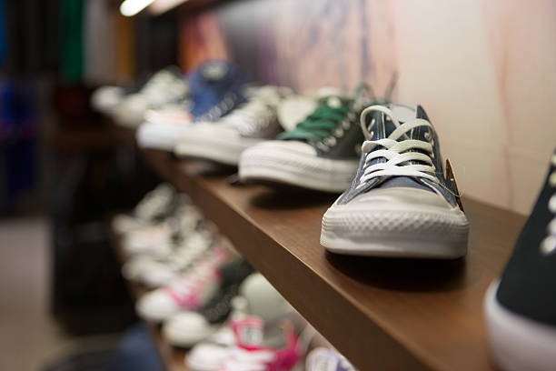 sneakers - retail display stock photos and pictures