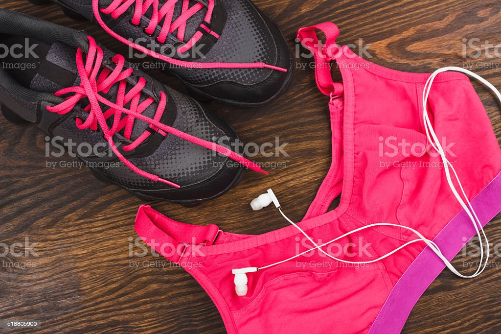 Sneakers, shorts and sports bra stock photo
