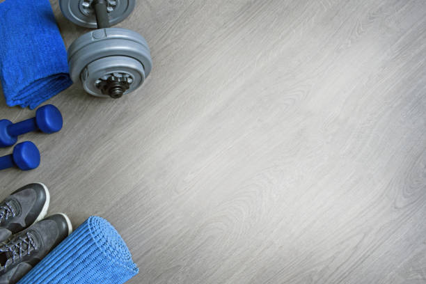 Sneakers two blue dumbbells a towel and a workout mat picture id1062433488?b=1&k=6&m=1062433488&s=612x612&w=0&h=qjjv41qr koemphx3jg8epkyq94vh3lt4o2nnf3gf s=