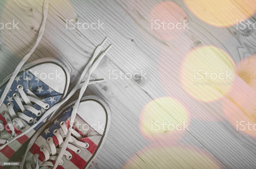 Sneakers with USA flag on wooden background stock photo