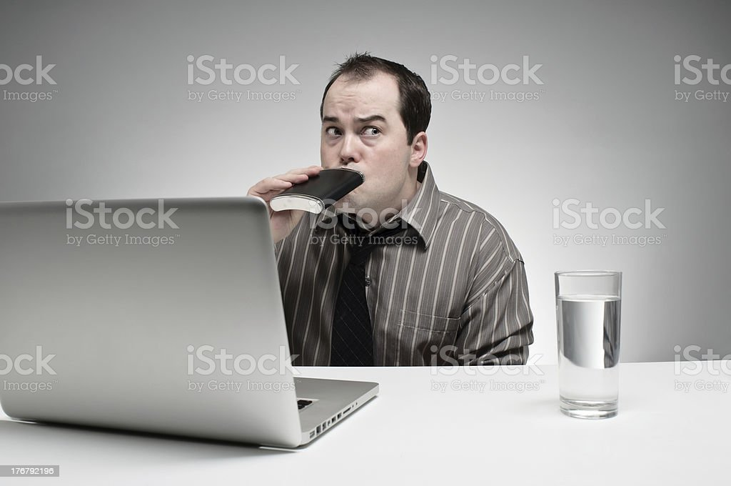 Sneaking A Drink At Work stock photo