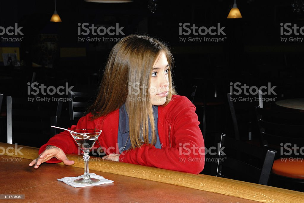 Sneaking a Drink stock photo