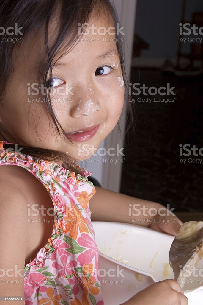 Sneaking a lick off the spoon royalty-free stock photo