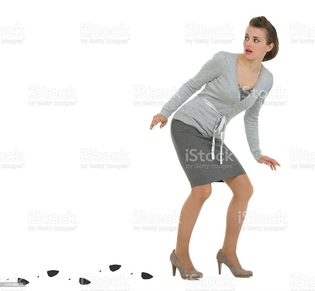 sneaking business woman leaving trace stock photo