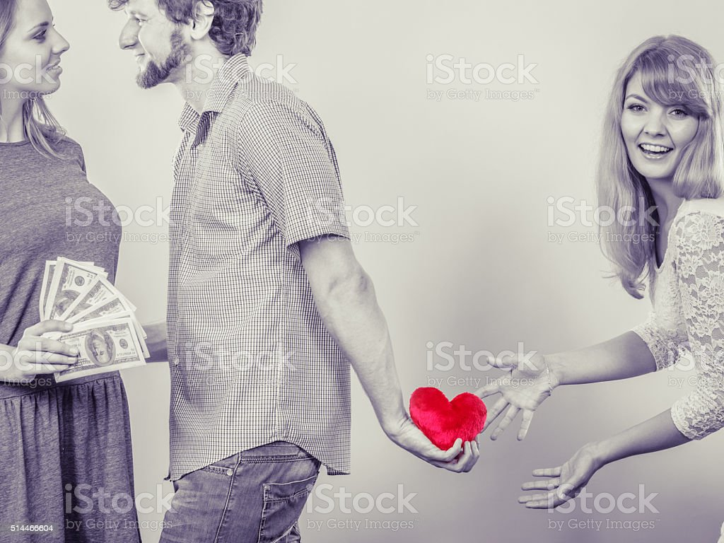 Sneaky man with two women stock photo