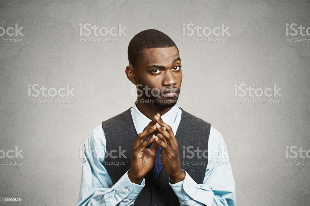 sneaky, sly, scheming young business man, worker trying to plot something stock photo