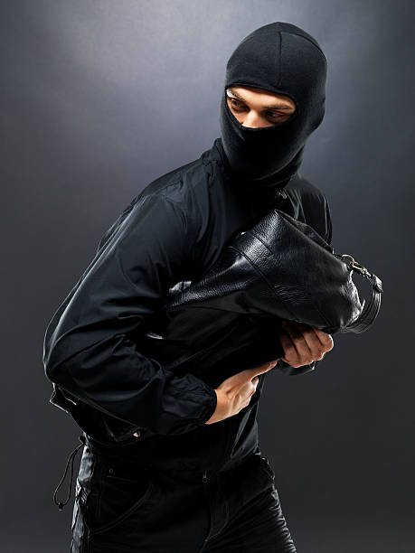 Sneaky thief making off with some loot stock photo