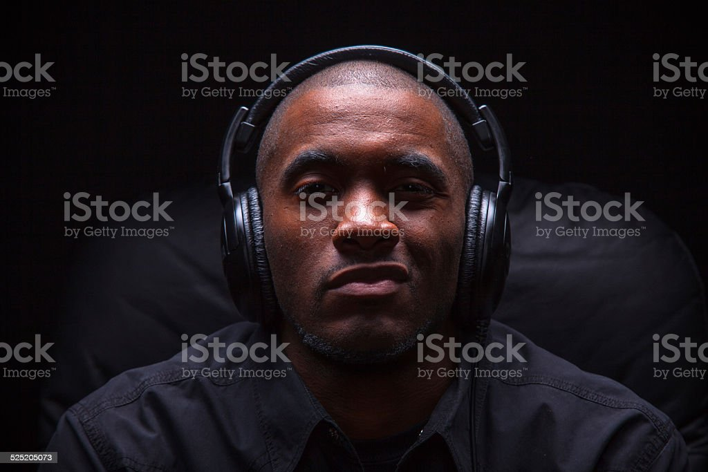Sneering Man Listening to Music stock photo