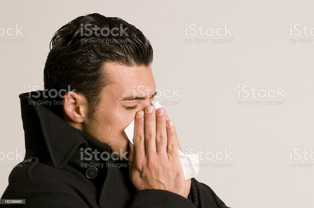 sneezing man stock photo