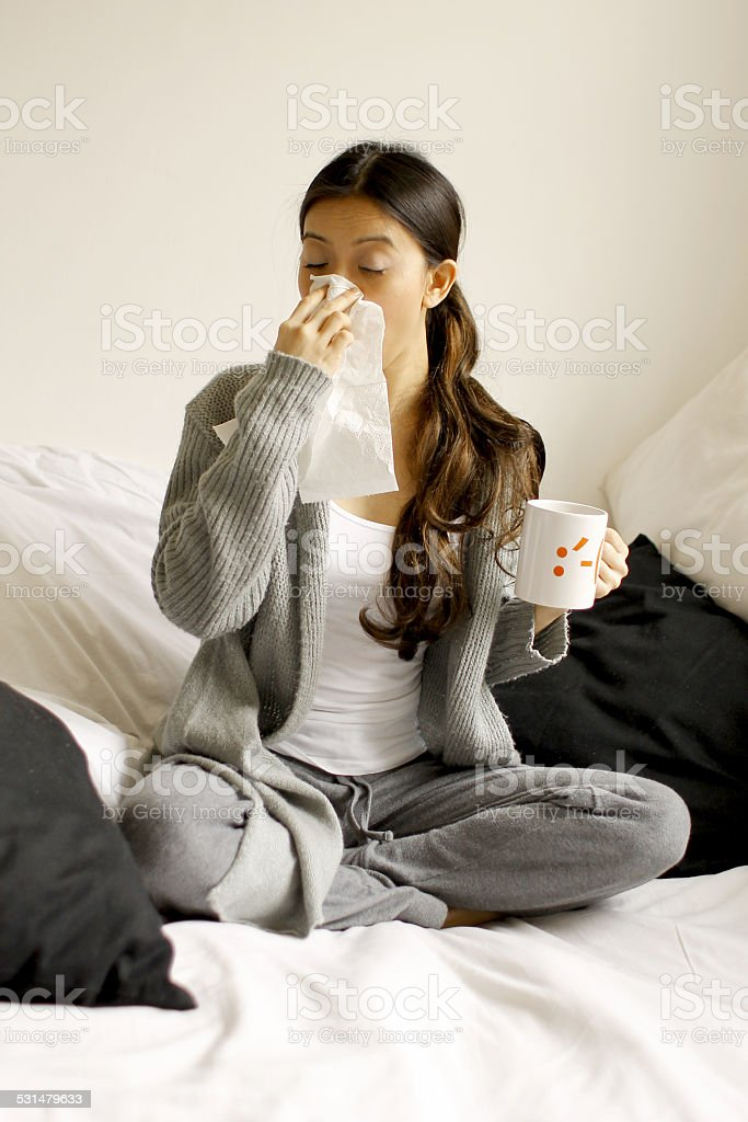 Sneezing woman stock photo