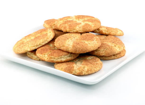 Snickerdoodles Snickerdoodle cookies on a plate. sugar cookie stock pictures, royalty-free photos & images