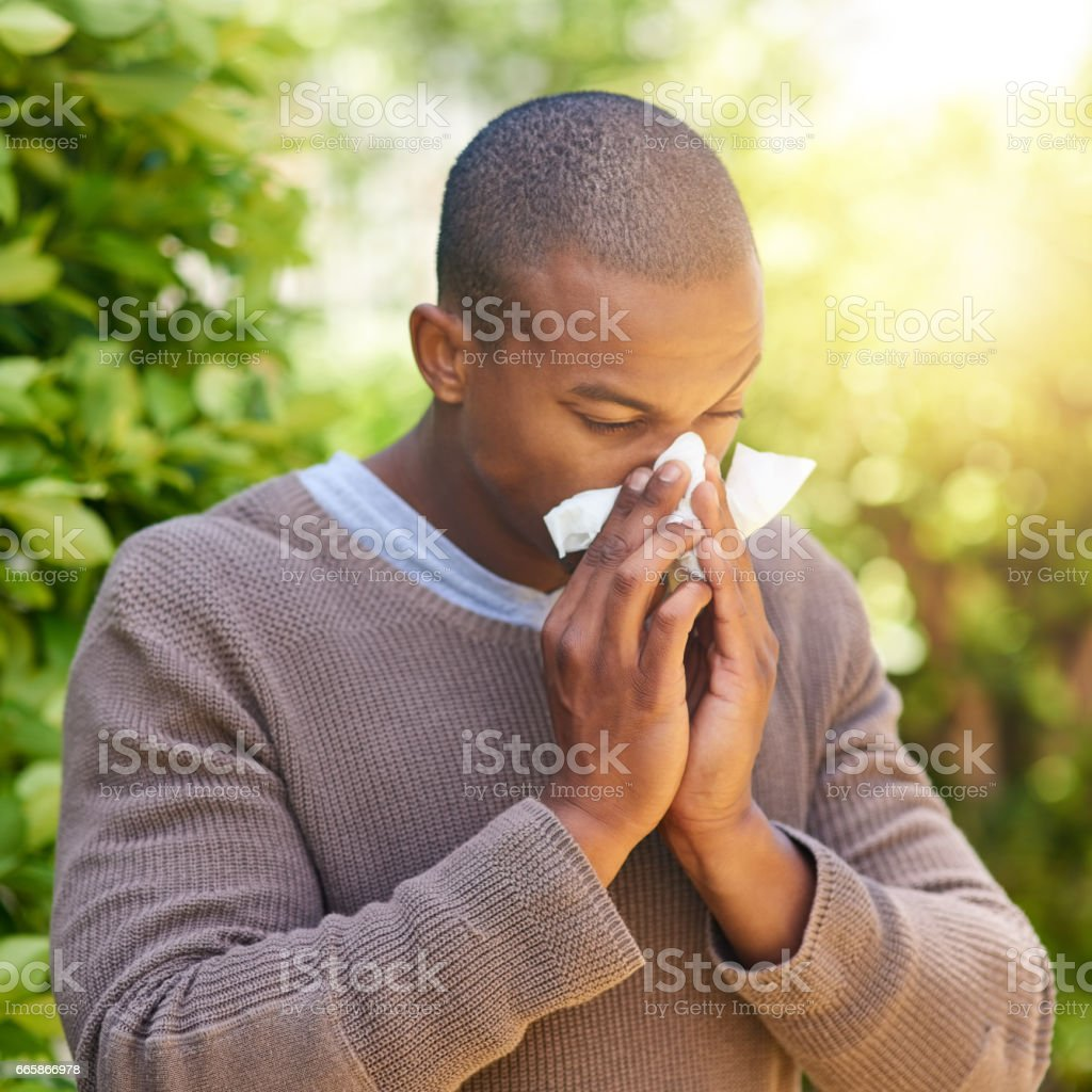 Sniffles, sneezes and wheezes stock photo