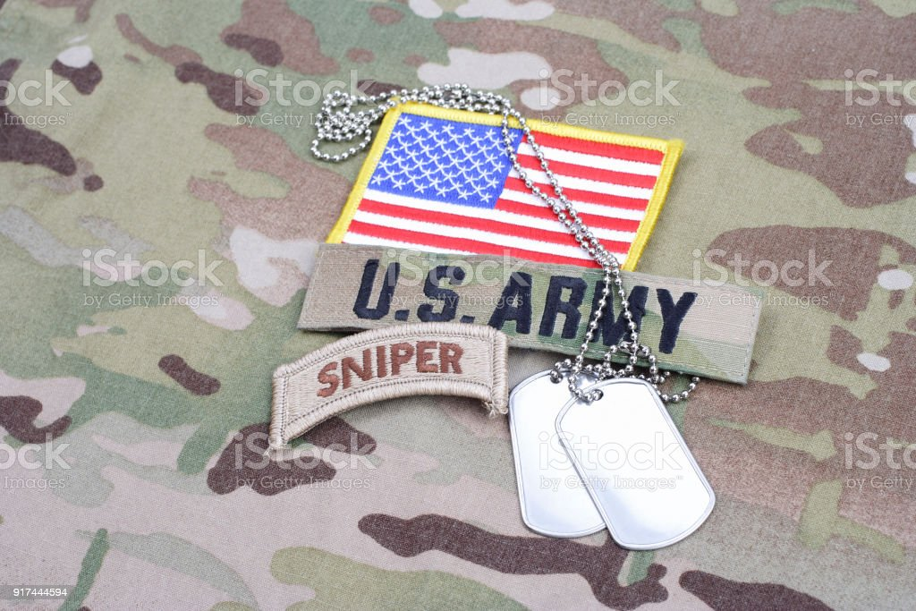 US ARMY sniper tab, flag patch, with dog tag on camouflage uniform stock photo