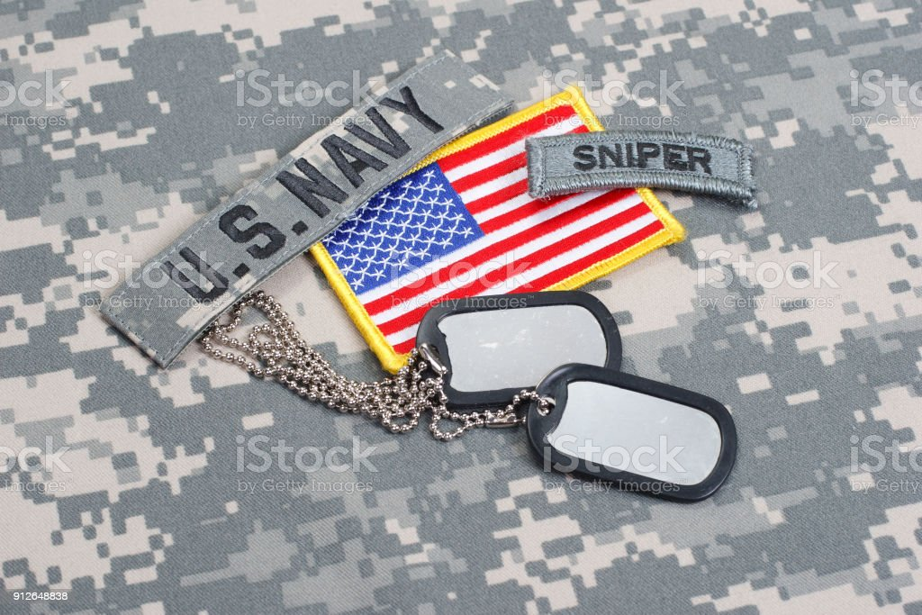US NAVY sniper tab with blank dog tags on camouflage uniform stock photo