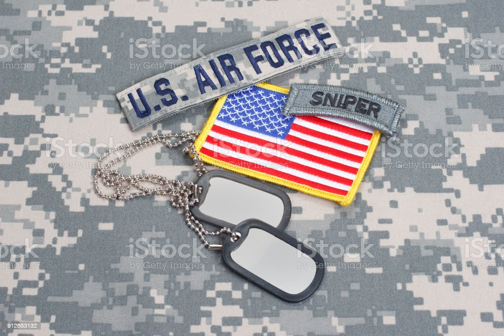 US AIR FORCE sniper tab with blank dog tags on camouflage uniform stock photo