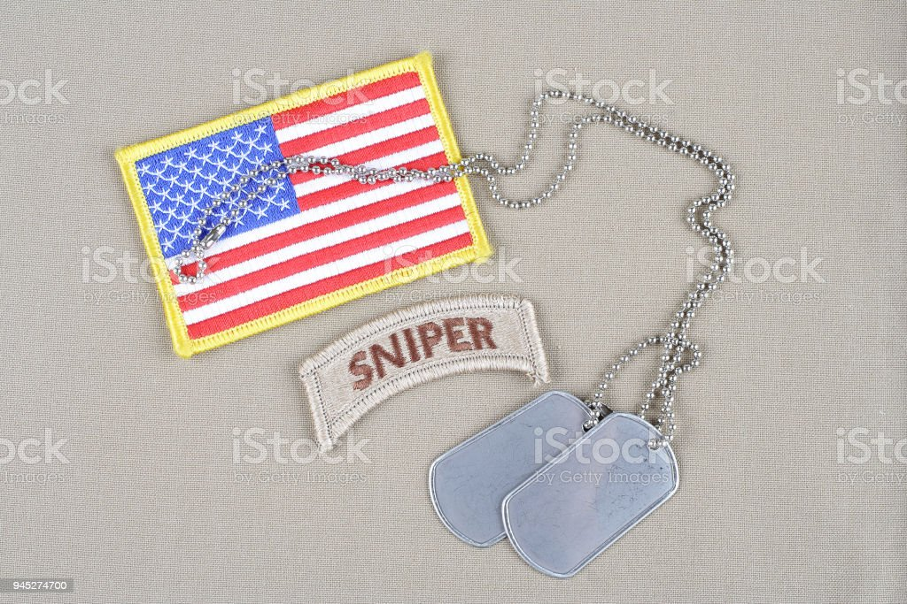 US ARMY sniper tab with dog tag  and flag patch stock photo