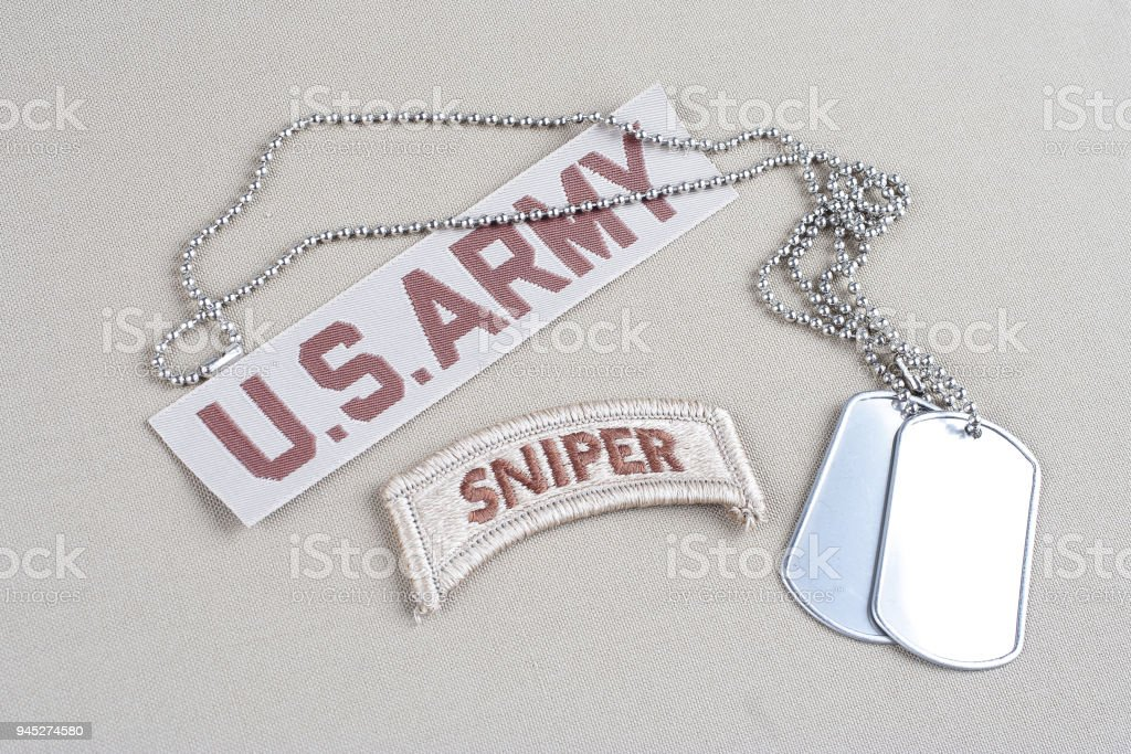US ARMY sniper tab with dog tag stock photo