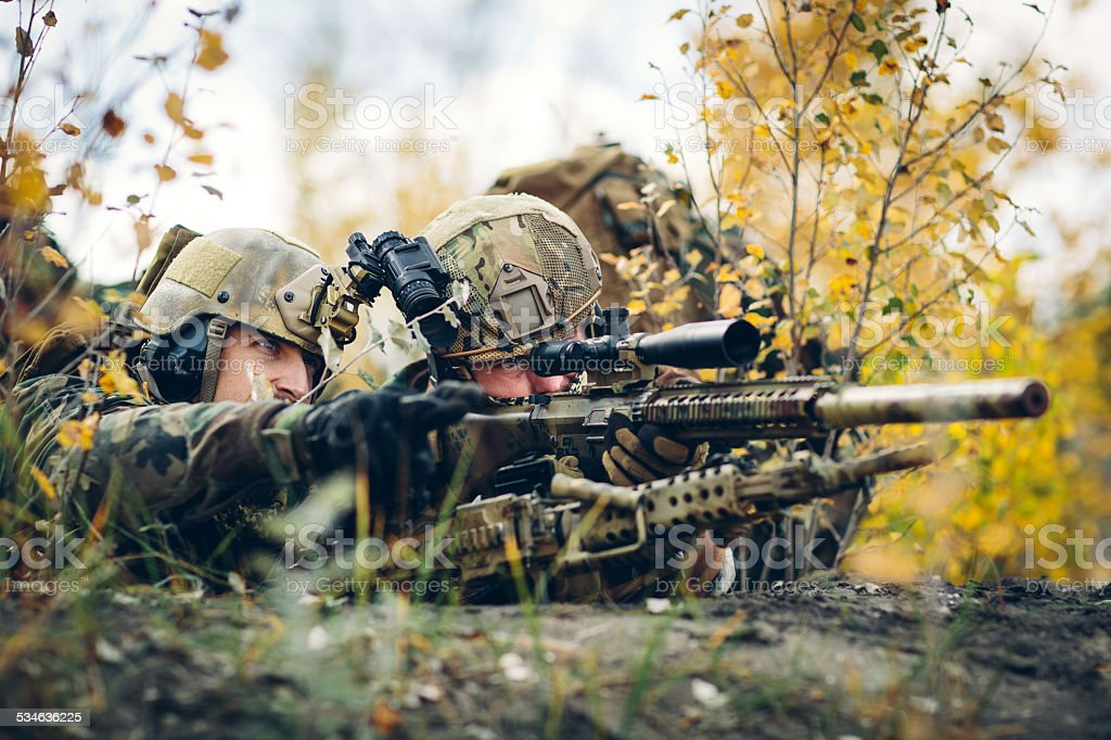 sniper team looking at the target stock photo