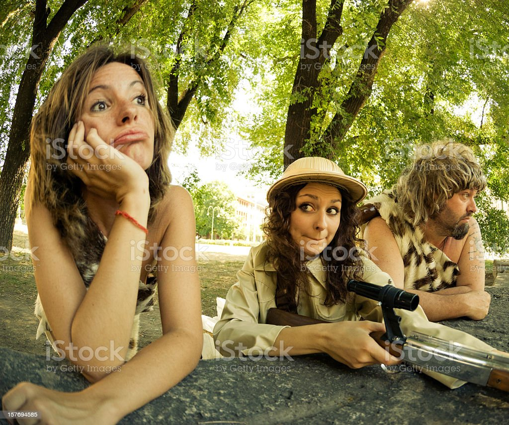sniper woman and prehistoric men with girl royalty-free stock photo