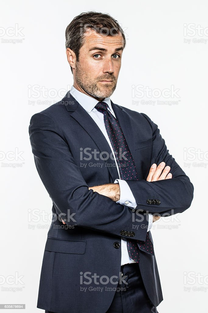 snob middle aged businessman with arms crossed standing with arrogance stock photo