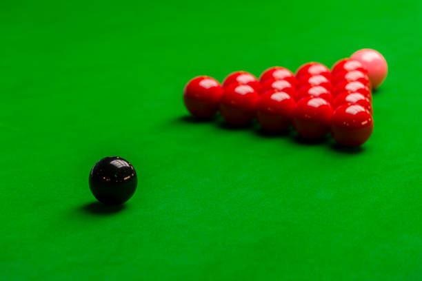 Snooker balls and table with green cloth side view stock photo
