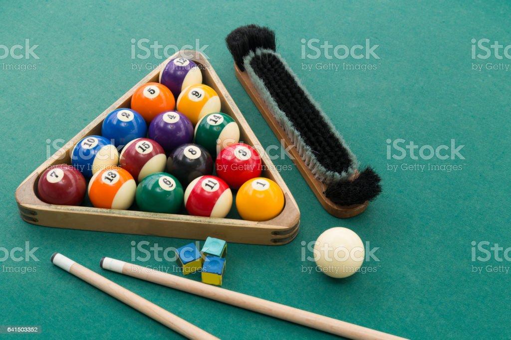 Snooker billards pool balls, cue, brush, chalk on green table stock photo