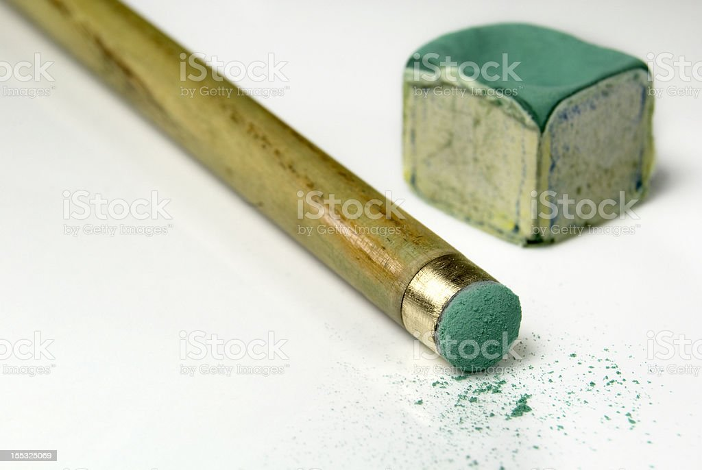 Snooker cue and chalk stock photo