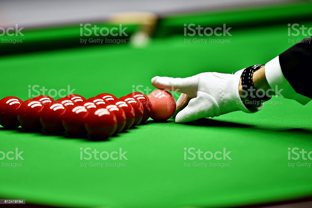 Snooker referee arranging pink ball stock photo