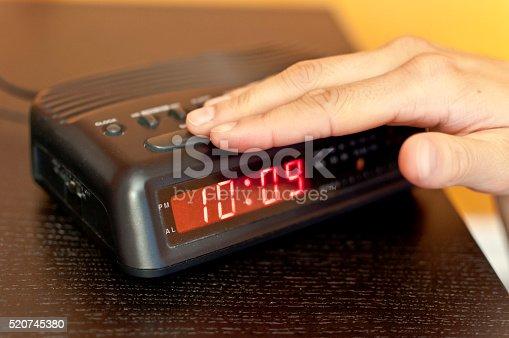 istock Snoozing the morning alarm 520745380