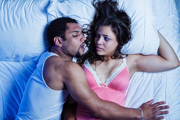 Snoring Husband stock photo