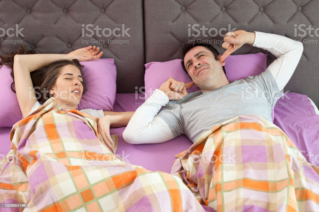 Snoring woman. Couple in bed, woman snoring and man can not sleep,